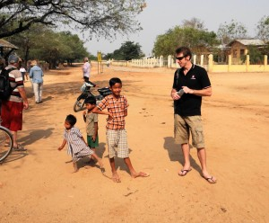 Aaron - Travel Indochina tour leader - chatting with local kids